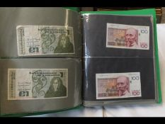 An album of collectable bank notes from around the