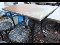 A cast metal and wooden pub/garden table