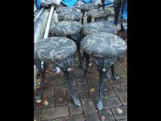 A set of eight cast metal pub stools