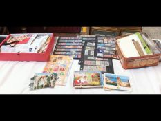 A box and tin of collectable stamps together with