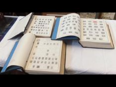 Three large global stamp albums containing a small