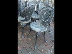 A set of four decorative cast metal pub/garden cha