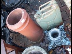 A terracotta chimney pot, jerry can etc