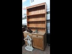 A pine dresser with associated plate rack over