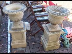 A decorative garden plant pot on stand together wi