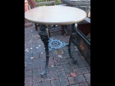 A circular cast iron and wooden pub table