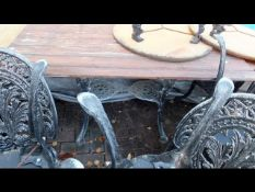 A cast metal and wooden garden/pub table