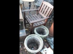 A pair of decorative garden pots together with a w