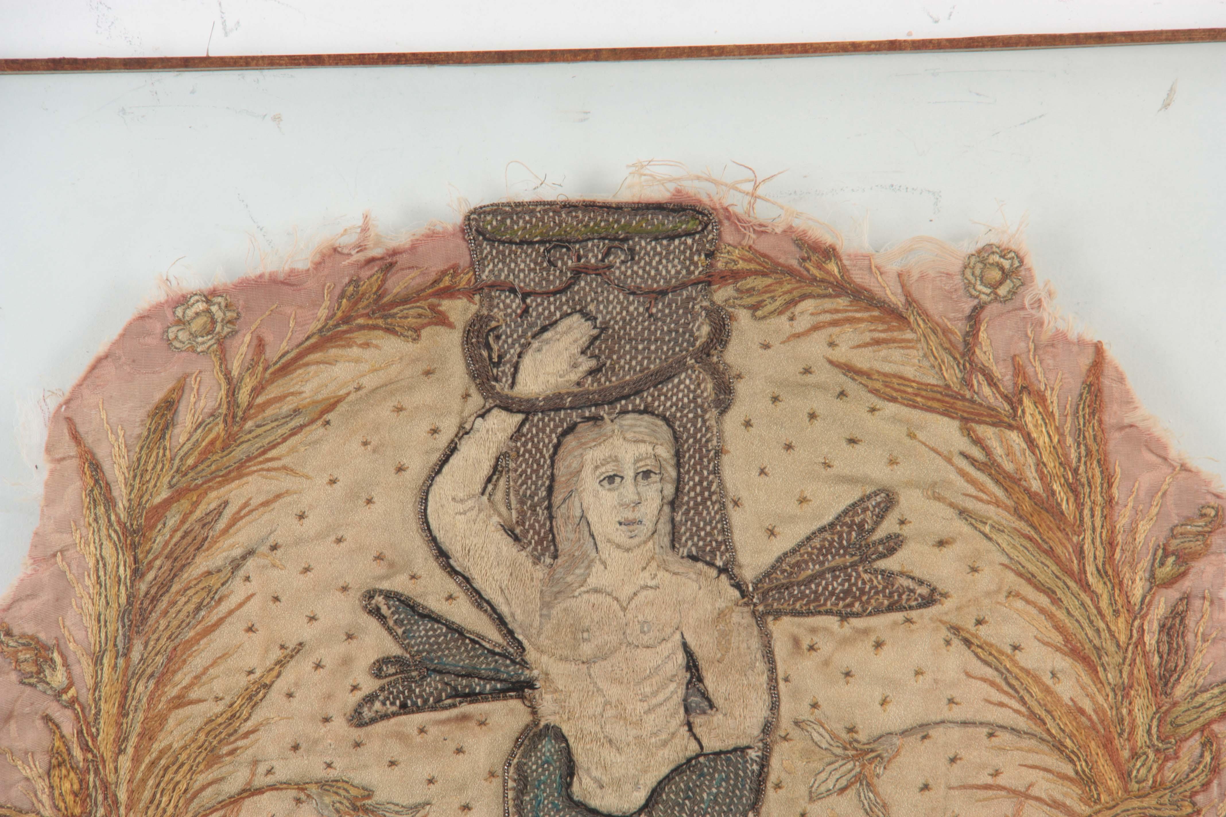 Lot 643 - A 17TH CENTURY SILK EMBROIDERED STUMPWORK PANEL depicting a standing figure of Saint Sebastian