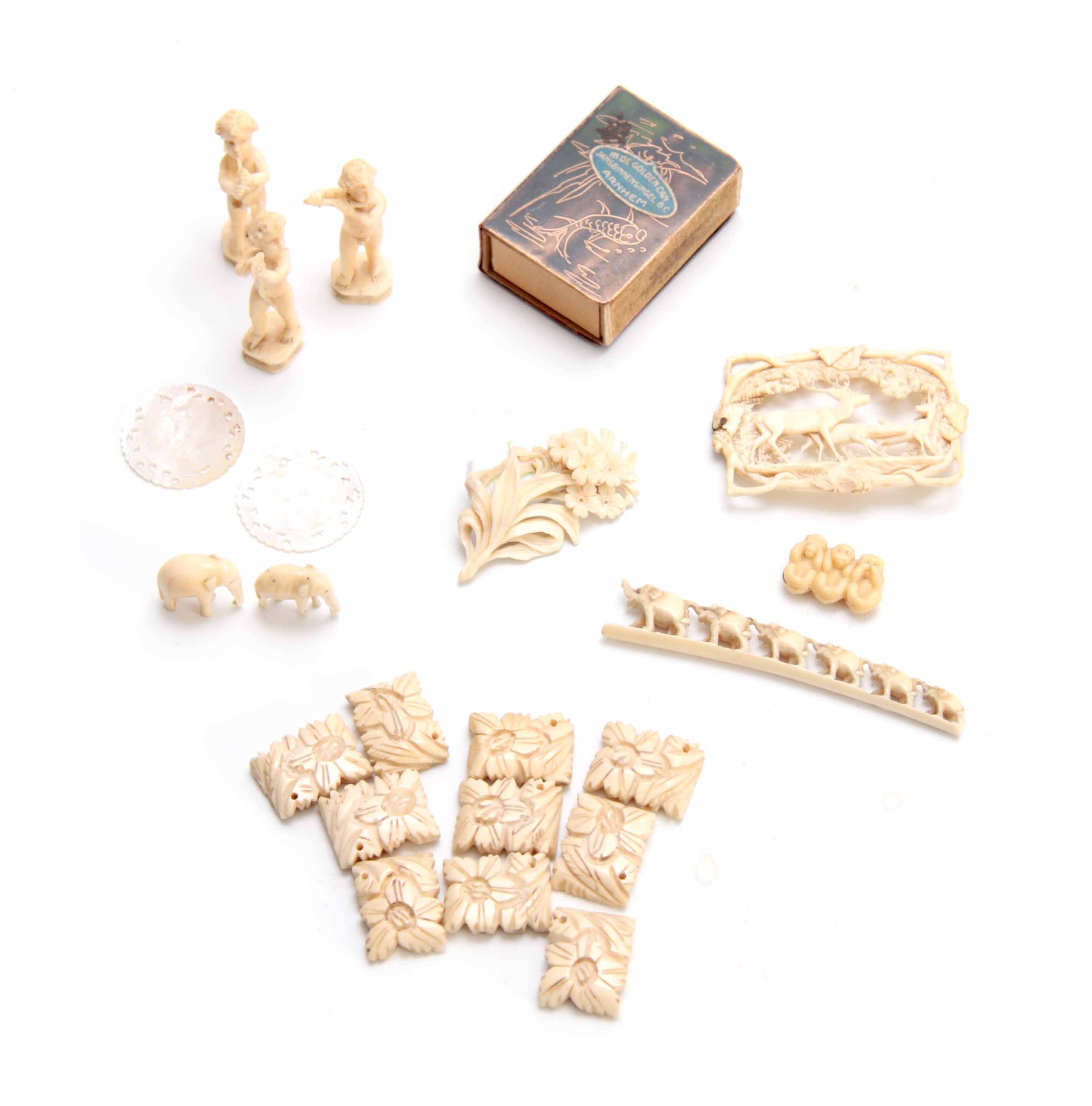 Lot 178 - A COLLECTION OF 19TH CENTURY CARVED MINIATURE IVORY PIECES including a belt buckle, a floral