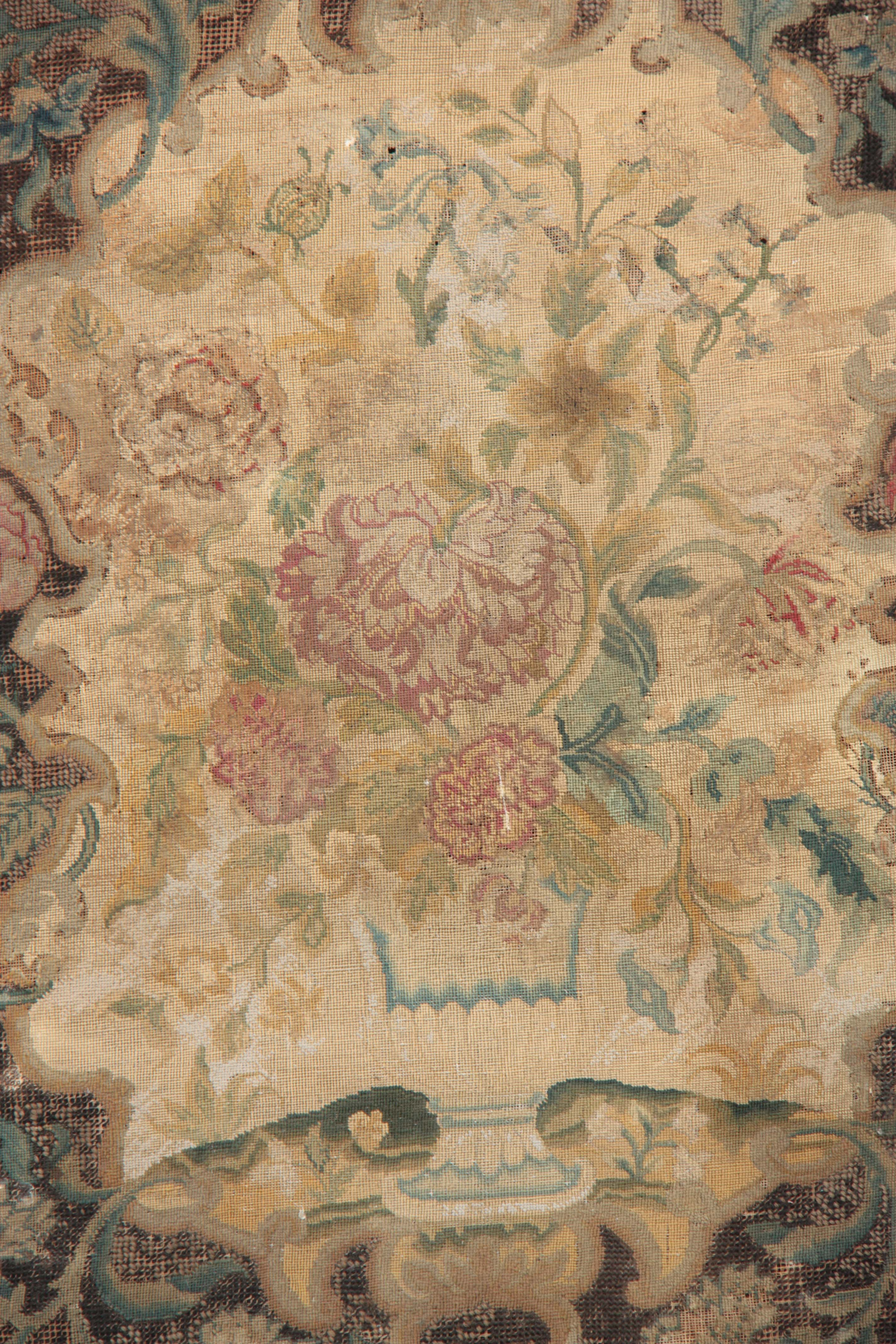 Lot 645 - AN 18TH CENTURY EMBROIDERED PANEL depicting flowers 82cm high 63cm wide.