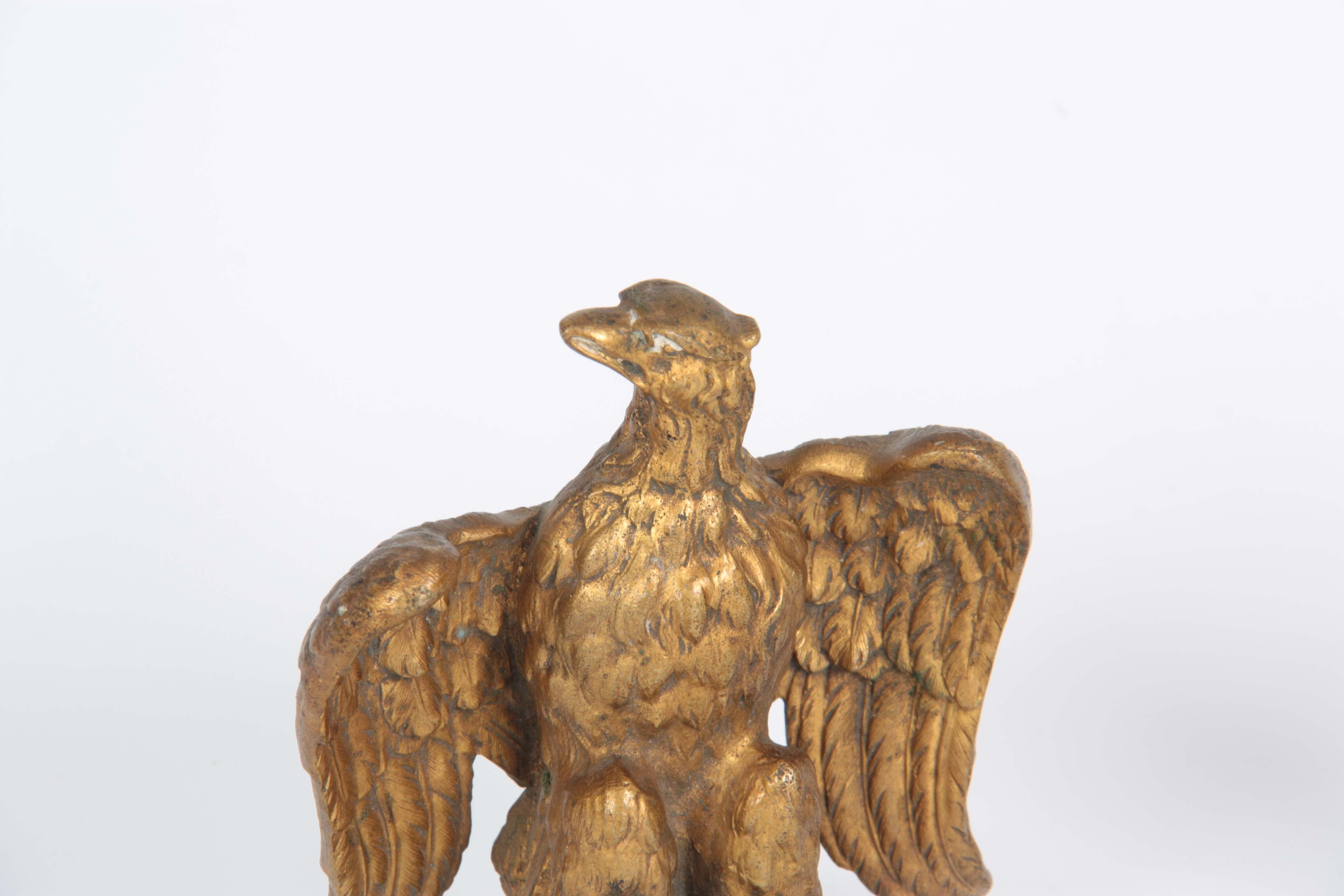 Lot 642 - A PAIR OF 19TH CENTURY GILT BRONZE EAGLES 12cm wide 14.5cm high.
