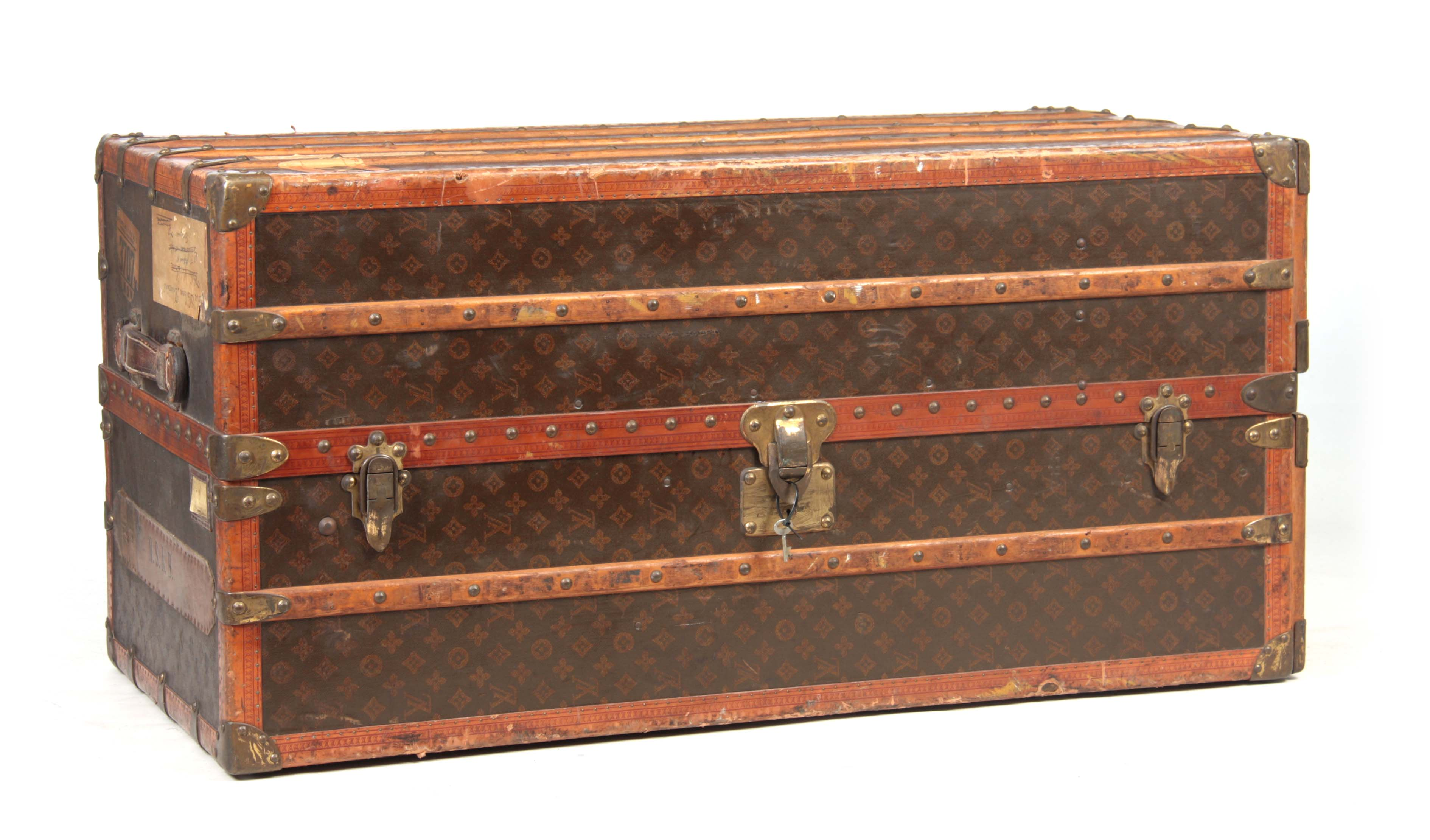 Lot 521 - A 1920'S LOUIS VUITTON MONOGRAMMED BROWN LEATHER WARDROBE TRUNK with studded slatted bindings, brass