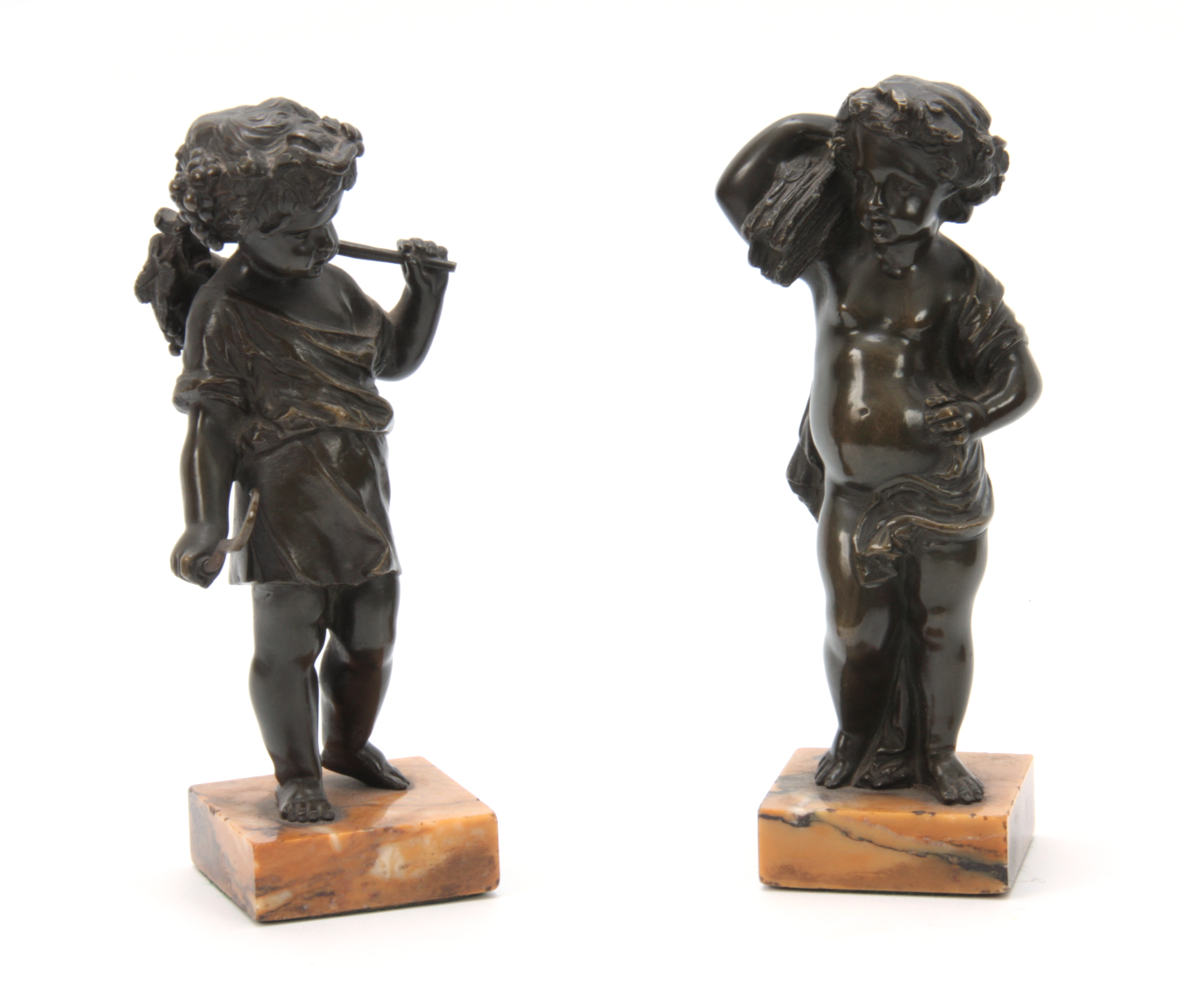 Lot 640 - A PAIR OF 19th CENTURY PATINATED BRONZE SCULPTURES modelled as putti harvesters mounted on Sienna