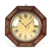 A REGENCY BRASS INLAID OCTAGONAL CASED WALL CLOCK the figured mahogany case with brass scroll inlaid