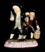 A 19TH CENTURY STAFFORDSHIRE PEARLWARE FIGURE GROUP modelled as The Parson and Clerk, the two