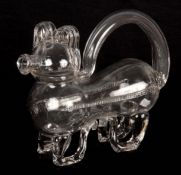 AN UNUSUAL 19TH/20TH CENTURY CLEAR GLASS DECANTER modelled as a dog, 23cm across 18cm high