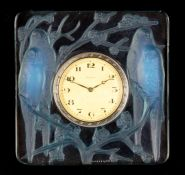 AN R LALIQUE INSEPARABLES OPALESCENT CLOCK WITH BLUE TINTING 1920's of square relief moulded form