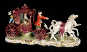 A GERMAN DRESDEN STYLE VIEUX SAXE FIGURE GROUP modelled as a carriage and horses set with figures,