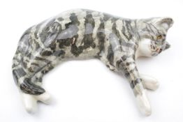 Large Winstanley Cat in laying pose, signed to underneath