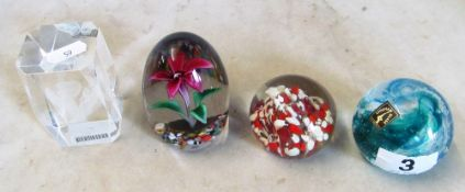 A Langham glass paperweight and three others