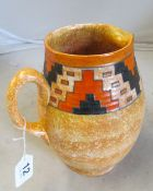 A Charlotte Rhead Crown Ducal jug orange/yellow mottled ground with geometric band in orange and