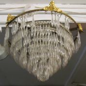 A pair of circular eight tier ceiling light with loose lustres