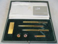 A Dunhill lighter, pen, cufflink and tie pin set (i.c)