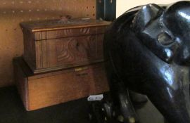 A pair of large ebony elephants, two smaller and two wooden boxes