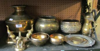 A brass elephant stand and various eastern brass bowls