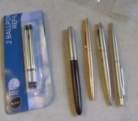 Two Parker pens and two other pens