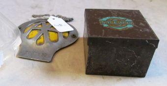 An AA car badge and a Spero tin