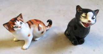 A Staffordshire style cat, two Royal Doulton cats and another cat