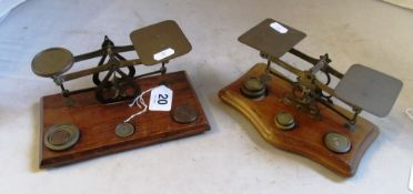 Two sets of brass postal scales