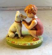 A Royal Dux figure boy with dog