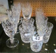 A set of six cut glass wine glasses, six small tumblers and two larger tumblers
