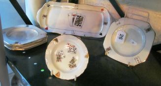 A Carlton ware dish, side plates with playing card design and Limoges card ashtray