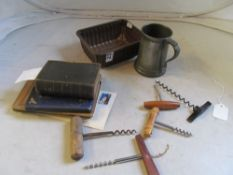 Various corkscrews, pewter tankard and a small group of books etc