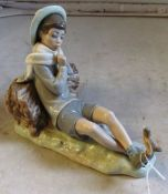 A Lladro figure boy with bird on his foot