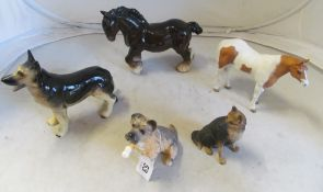 A Royal Doulton dog and four animals