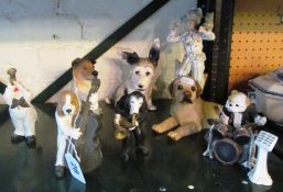 A four piece resin dog band and other dog ornaments