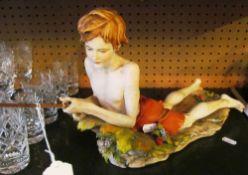 An Italian figure of a boy fishing