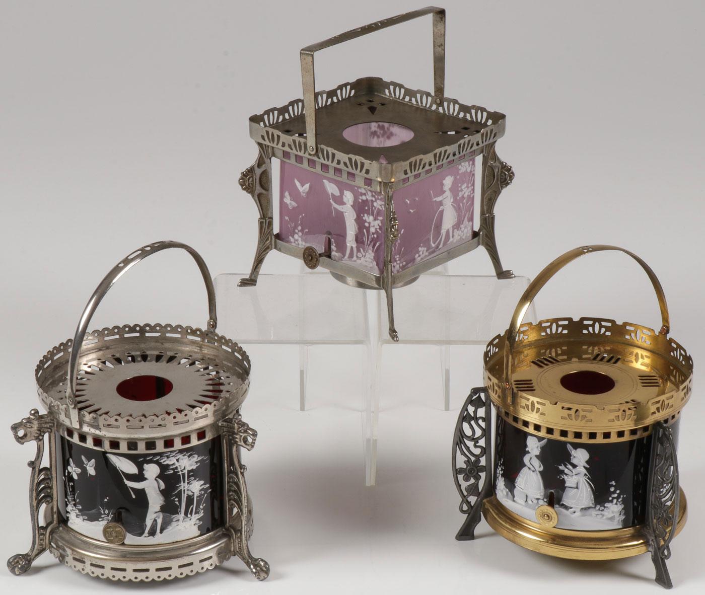Lot 60 - THREE MARY GREGORY TEA WARMERS