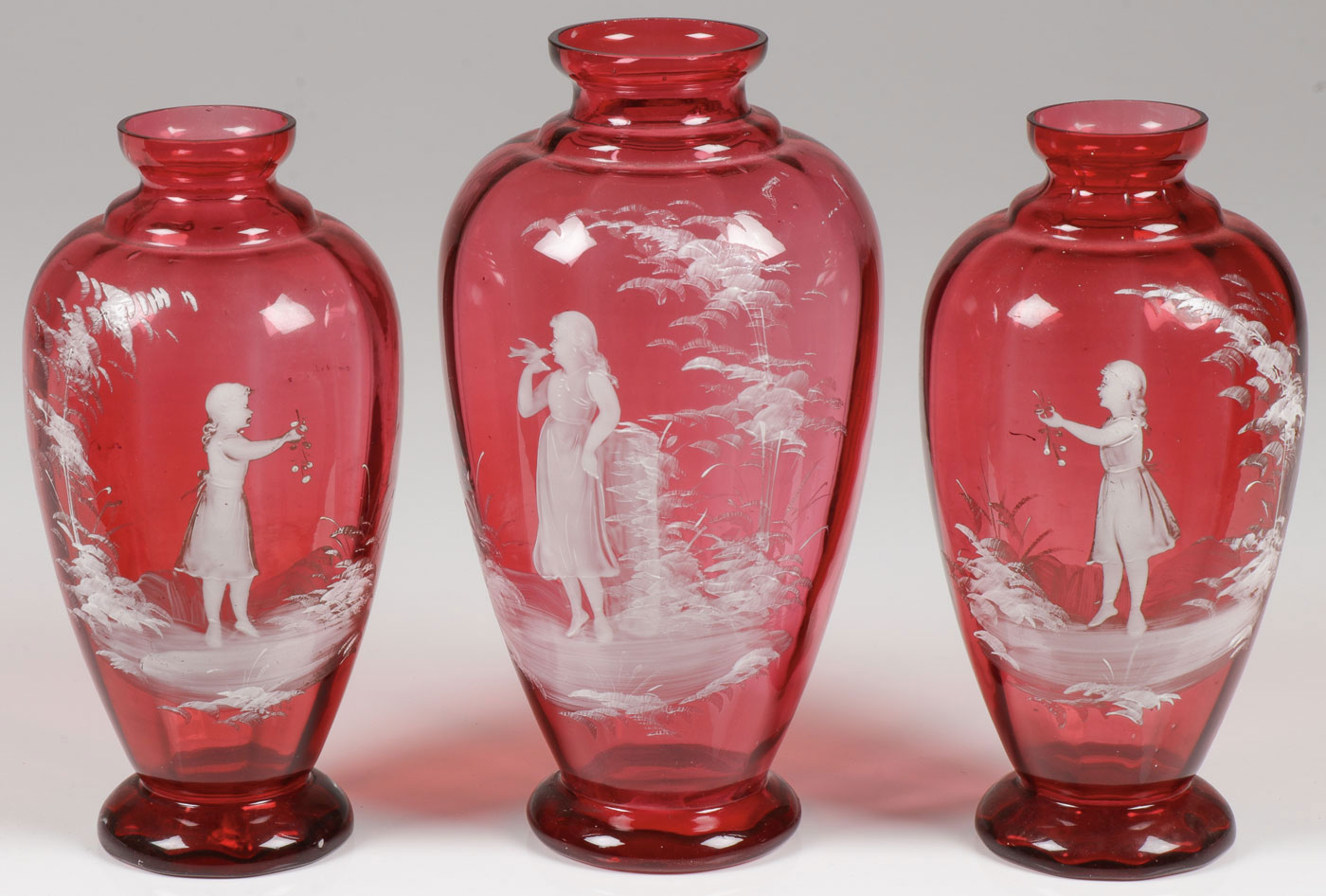 Lot 58 - THREE MARY GREGORY CRANBERRY VASES
