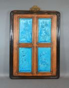 A Chinese Panel Inset with four blue glazed porcelain panels 58cm x 43cm