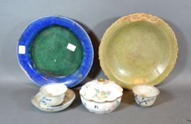 An Early Chinese Green Glazed Dish together with another dish, two tea bowls, a saucer and a