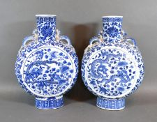 A Pair of 19th Century Chinese Moon Flasks each decorated in underglaze blue with serpents amongst