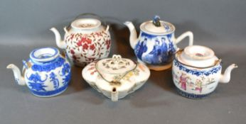 A Canton Teapot Decorated in Polychrome Enamels together with four other similar teapots to