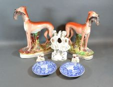A Pair of Staffordshire Models of Greyhounds together with a Staffordshire group, a pair of small