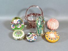 A Millefiori Glass Paperweight together with five other similar glass paperweights and a small glass